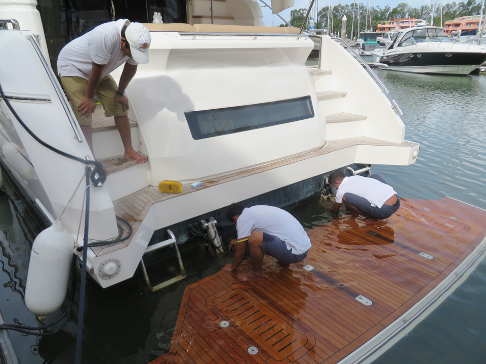 Yacht crew training. Checking underwater gear